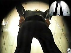 Hot girl in black pours out tight streams in a WC
