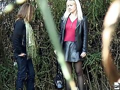 Blonde in black pantyhose pissing outside