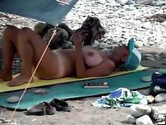 Big-breasted woman sunbathing all naked
