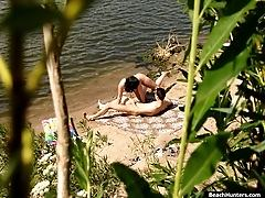 Cowgirl rides a guy on a river spy shore