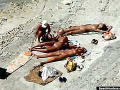 Nudists change and tan on the spy cams