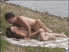 Flirty brunette gets her pussy stuffed on a river beach