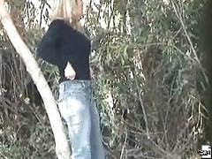 Blonde yields to an urge in the forest