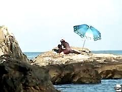Unsuspecting chick is filmed sunbathing on a beach