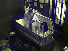 Security cam footage of a couple breaking in a coffin